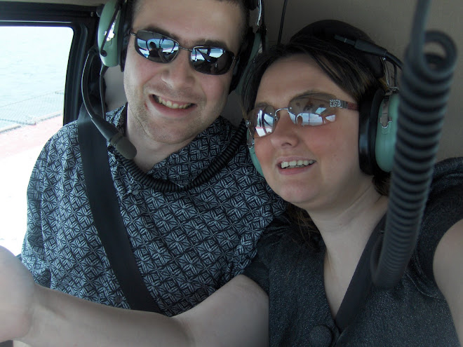 Scott and Laura in a helicopter