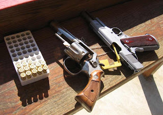 Smith & wesson Model 10-8 and Colt Gold Cup National Match Click to enlarge
