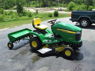 picture of John Deere Plug Aerator and X300 Mower