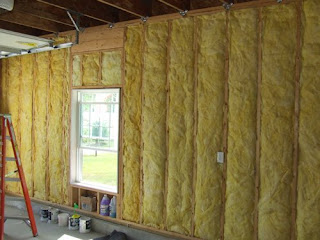 picture of fiberglass insulation in garage walls