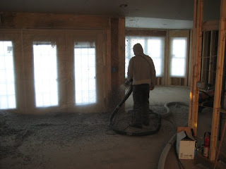 picture of man spraying nu-wool cellulose insulation