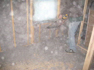 picture of man shaving spray-in-place nu-wool cellulose insulation on wall cavities