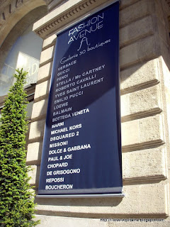 Sign with list of luxury brands in Bordeaux