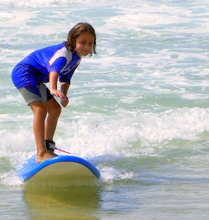 Clara surfing at Erretegia beach in Bidart