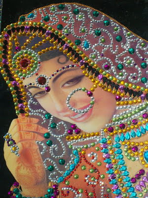 This is the portrait of Indian bride made with gem stones.