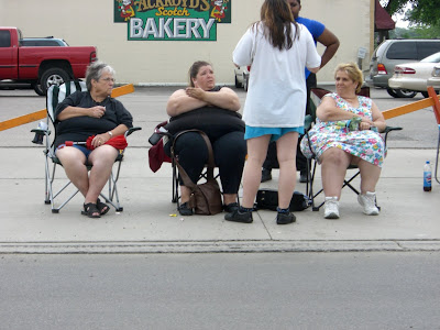 fat women watching the parade