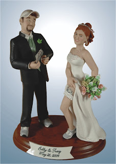 wedding cake topper showing a groom putting money in a bride's garter
