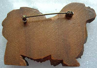 Back of wood Peke brooch