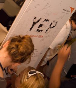Signing the 2008 YEP poster