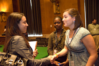 Hannah Alley of Picayune, right, shakes hands with IMPACT member, Angela Rye. Center is Malon Murphy of Los Angeles.