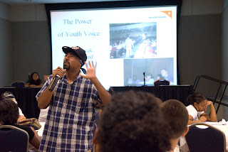 Juan Pacheco wears the attire of his past in the Power of the Youth Voice workshop.