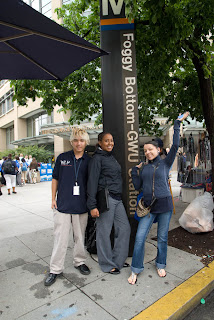 Akira Casch, Fundisha Tibebe, and Luisa Ashenfelter, of the Seattle delegation, stand at the Foggy Bottom Metro stop.