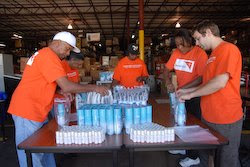 World Vision staff members and volunteers pack up more personal hygiene kits to ship to victims of Hurricane Ike.