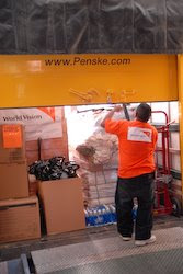 World Vision staff member, Pedro Escobar, closes up the truck filled with supplies that are bound for the areas hardest hit by Hurricane Ike along the Texas coast.