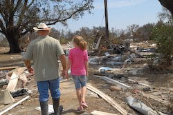 Adam Saunders takes his daughter, Olivia, to visit what used to be their home.