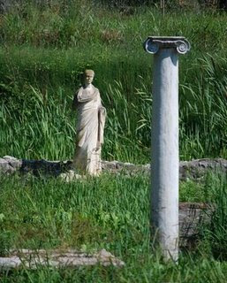 grass in greece with statue framgents