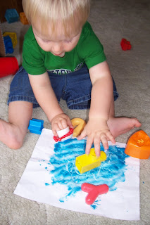 toddler doodling in playdough