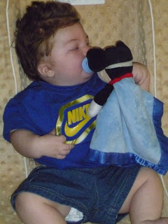 baby mason with mickey mouse lovey