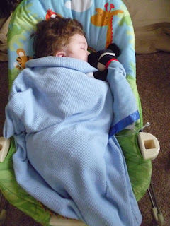 baby mason sleeping in bouncer