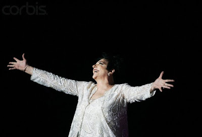 Dramatic Liza Minnelli has a fire shaped palm