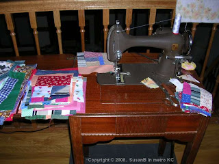 mile-a-minute quilt blocks at sewing machine