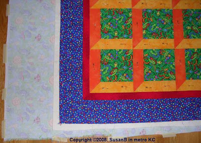 pin-basted quilt top