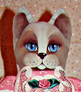A close-up of one of my hand-painted Cat dolls.