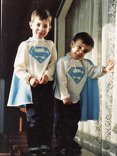Playing 'Superman' with home-made outfits.