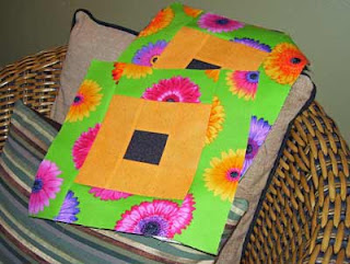 Two of the brightly colored blocks - eye popping big daisies.