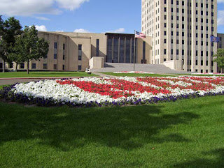 Every year the flowers are planted in in such a way that the different colors spell out 'North Dakota' in front of the building.