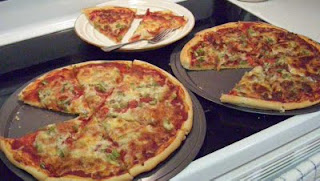 These two pizzas are pepperoni and Italian sausage. Mmmmn!