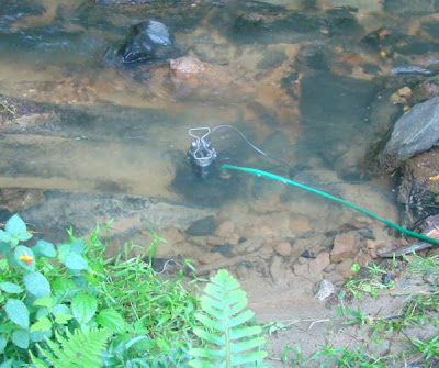 Sump pump placed in creek