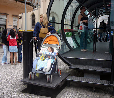 wheelchair lift being used by mom with stroller