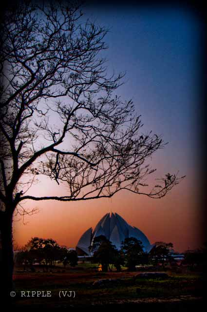 Sunset View @ Lotus Temple, Nehru Place, Delhi: The Baha'i House of Worship in Delhi which is popularly known as the Lotus Temple due to its flower like shape, is a Bahá'í House of Worship and also a prominent attraction in Delhi. It was completed in 1986 and serves as the Mother Temple of the Indian subcontinent. It has won numerous architectural awards and been featured in hundreds of newspaper and magazine articles.: Posted by VJ on PHOTO JOURNEY @ www.travellingcamera.com : VJ, ripple, Vijay Kumar Sharma, ripple4photography, Frozen Moments, photographs, Photography, ripple (VJ), VJ, Ripple (VJ) Photography, VJ-Photography, Capture Present for Future, Freeze Present for Future, ripple (VJ) Photographs , VJ Photographs, Ripple (VJ) Photography :