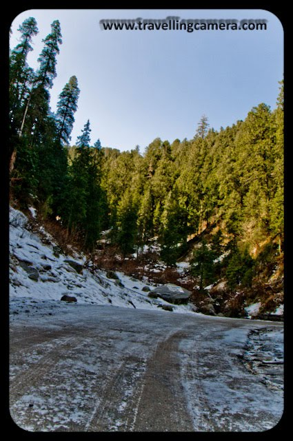 Dalhousie, Himachal Pradesh,  Snow,When I headed out for Dalhousie, I had no idea that a surprise awaited me. SNOW. My first ever!! Here are some pics.Freshly fallen Snow with Tyre Tracks. It was Slippery. I had to be very careful. My guide duly warned me of the dangers.Bright-Colors Look Incredible against the black and white back ground. No wonder the Bollywood Actresses prefer do away with woollens when shooting in freezing cold. A huge pile of snow. Unlike the first picture, this was far more compacted and lookeda little muddy.It took a lot of courage to maintain a straight face in the chill.Couldn't take it any more and put the jacket back on. Wasn't done with the snow though and got some more pics clicked. Many of them didn't turn out to be good. But thankfully a handful came out alright.My guide told me that this was actually what is called a Nalla locally. It is so different from the Nallas in Delhi.Children playing around.