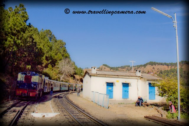 Small and Beautiful Railway Stations on Kalka-Shimla narrow track: Posted on www.travellingcamera.com by VJ: The Kalka-Shimla Railway built to connect the summer capital of India in 1903 at an altitude of 2076 meters offers a panoramic experience of the picturesque Himalayas from the shivalik foot hills at Kalka to several important points such as Dharampur, Solan, Kandaghat, Taradevi, Barog, Salogra, Summerhill, Shimla and beyond up to the silvery snow line near the towering peaks.Sonwara Railway Station on the way to Shimla from Kalka...Himalyan Queen waits for 30 minutes at this station to let Shivalik Express pass through....  KOTI Railway Station on the way to Shimla from Kalka...I have clicked these photographs during recent visit to Shimla.... We reach KOTI Railway Station after crossing longest Barog tunnel....Jabali Railway Station on the way to Shimla from Kalka...Kandaghat Railway Station on the way to Shimla from Kalka...Located at an altitude of 4680 ft above sea level Kandaghat is the nice place in Himachal Pradesh for you if are looking for a quiet and peaceful vacation. Maharaja Bhupinder Singh built his palace in Kandaghat after which this place received the attention. Raja Bhupinder Singh was the ruler of Patiala and when he was expelled from Shimla, he set up base in Kandaghat. Today, this is one of the most popular destinations to travel in India.  A reflection of Kandaghat Railway Station on train window...Dharmpur Railway Station on the way to Shimla from Kalka..Just 15 km from Kasauli on the National highway No.22 Dharampur has one of the best hospitals in India for the cure of tuberculosis. It is also connected by Kalka Shimla railway line.... Shoghi Railway Station on the way to Shimla from Kalka...SHoghi is a small town near Shimla and now its being developed as new tourist destination in Himachal. There are many resorts with good facilities in Shoghi and have reasonable arrangements for tourist groups..Kandaghat Railway Station on the way to Shimla from Kalka..Delux Rail-Car standing @ Shoghi Station...Tara-Devi Railway Station on the way to Shimla from Kalka...Tara Devi temple is located on Tarav Parvat, in the western side of Shimla. Temple provides an overwhelming view of the mountains below and Shimla Town. Every year thousands of pilgrims visit Tara Devi temple, which has a great spiritual and heritage value. Historically speaking, the temple was built approximately 260 years ago ...Salogra Railway Station on the way to Shimla from Kalka..Kalka Railway Station...Kalka is a town in the Panchkula district of Haryana in India. The name of the town is derived from the goddess Kali. The town is situated in the foothills of the Himalayas and is a gateway to the neighbouring state of Himachal Pradesh. It is on the National Highway 22 between Chandigarh and Shimla and is the terminus of the Kalka-Shimla Railway. To the south of Kalka is Pinjore and the industrial town of Parwanoo (Himachal Pradesh) is to the north on the NH 22. Industrial development has led to a continuous urban belt from Pinjore to Parwanoo, but Kalka remains largely unaffected by these developments. Nearby is Chandimandir Cantonment where the Western Command of the Indian army is based. SHIMLA became the summer capital of British India in 1864 and was also the headquarters of the British army in India. Prior to construction of the railway communication with the outside world was via village cart.The railway was constructed by the Delhi-Umbala-Kalka Railway Company commencing in 1898. The estimated cost of Rs 86,78,500, however, the cost doubled during execution of the project. Because of the high capital and maintenance cost, coupled with peculiar working conditions, the Kalka-Shimla Railway was allowed to charge fares that were higher than the prevailing tariffs on other lines. However, even this was not good enough to sustain the company and the Government had to purchase it on January 1, 1906 for Rs 1,71,00,000.