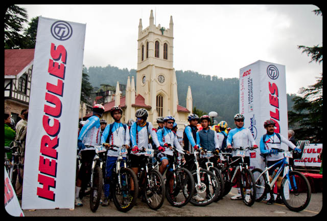 Starting of Mountain Terrain Biking Himachal 2010 from Shimla on 23rd October @ Himachal Pradesh, INDIA : Posted by VJ SHARMA : Its was morning of 23rd October and Ritz at Shimla(Himachal Pradesh, INDIA) was jammed with riders from various parts of the world... It was around 8:30 am when everyone was excited about this journey of 8 days to cover 500 kilometers and reaching heights of 3250 meters in Himalayas... Here are few photographs of 23rd Morning when MTB Himachal 2010 started... : One of the rider warming up at Ritz, Shimla, Himachal Pradesh, INDIA ... He is Saurabh Tandon from Delhi, INDIA ... Hercules was main partner in organizing this event... In the photograph above, all the riders are waiting for flag off by chief guest of the event... You can see the catholic church of Shimla in the background of this photograph.... Lot of media people were roaming around mall road and Ritz to cover this event... Here is a photograph of a journalist from Star News who is interviewing PADAM, who has won this race in 2008 and 2009... Padam is from Nepal and this time he got injured on second day of this race, which was very sad... But he was happy for his friends from Nepal and finally Ajay Pandit won... Padam had trained Ajay and he was very proud of that... Local MLA of Shimla giving inspirational speech to all riders... although many of them were more excited about the starting of the free ride till Mashobara :) .... She is Mayor of Shimla and participated as one of the main guests of starting event...HASPTA organized this event and here is some information about the organization in their own words:
