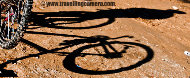 Morning Photographs of MTB Himachal 2010 at Tanni Jubber Camp on Third Day : Posted by VJ SHARAMA on www.travellingcamera.com Hope you have already checked photographs of THIRD DAY OF MTB HIMACHAL 2010 and here are few more photographs of starting of the day... We started from Tanni Jubber in the morning and this posting have some photographs of early part of the day... Check it out..Peter... I have seen him ready before time (everyday) and used to take sunbath till the time other folks get ready for final march... Most of the folks used to get ready on time, but somehow we never started on time :)Early morning colors of Tanni Jubber Lake in Himachal Pradesh....Everyone is ready and waiting in the main ground.. Lunch and other stuff is being loaded to the trucks on the left and other folks just having sunbath in chilling winters on Himalayas...Longer shadows of Riders and their bikes in early Morning of third day @ Tanni Jubber, Himachal Pradesh..Its the beginning and show for the day has to start yet.. So keep watching this space for other adventurous moments of Third day ...