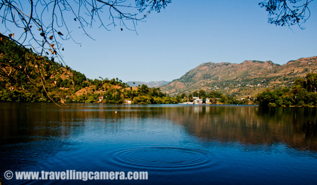 Lake at Naukuchiataal, Uttrakhand State of India - A popular hill Station : Posted by VJ SHARMA on The word Taal is used for lakes and that's why all the places in India having lakes are named with 'Taal' in the end... NaianiTAAL, NaukuchiaTAAL, SaatTAAL, BheemTAAL etc.. Especially in Uttrakhand state of Himachal Pradesh Taal is used with most of the main hill stations having lakes... Nainitaal is one of the main tourist place in Uttrakhand but now people like to go to less crowded places and Naukuchiataal is one of the tourist attraction in Uttrakhand due to comparatively less commercialization there... Here are few photographs of the Taal (Lake) in Naukuchiataal... Check Out !!!When we talk about the tourist places with lakes, how can we miss boating... In Naukuchiataal, there were lot of colorful boats to provide various rides to tourists... Apart from the ones you see in above photograph, there are other options like boats with pedals and kayaking etc... I had heard of many other water sports but couldn't see more than this.. The resort where we stayed had organized boating tour for us and it was good ... This lake is certainly different from others and surrounded by tree on one side and road on other part of it...Here is a view of Naukuchiataal Lake from Lake Resort which is located on the other side of this lake... There were very bright colors around this place and sunlight in hills is incomparable... Color of water is much brighter than the sky and tree around it make the place more beautiful !!!Two of my friends enjoying Kayaking at Naukuchiataal Lake..There are enough resorts and hotels in Naukuchiataal ... with good facilities for tourists... when we went for the morning during second day, we came across lot of guest-houses, resorts and cottages in the surroundings of Naukuchiataal Lake..Few old boats sitting on the other side of this lake... or probably not functioning during off season at Naukuchiataal..A view to Lake in Naukuchiataal from surrounding hills... We also climbed to one of the hills in the surrounding of this lake and me few villagers there... This lake is a body of still fresh or salt water in some ratio which is in a basin that is surrounded by land. Initially it was not very populated and now people from big cities have started buying land around it to construct houses/cottages etc...Another photograph of folks doing kayaking in a white kayak inside the lake @ Naukuchiataal, Utrakhand, INDIACheck out more photographs of this trip @Lake @ Naukuchiataal, Uttrakhand, INDIALake Village Resort @ Naukuchiataal, Uttrakhand, INDIAFlying in the sky... Paragliding experiences @ NaukuchiataalA weekend at Lake Village Resort in Naukuchiataal, Uttrakhand State of IndiaPlease leave your comments about this post and photographs... Critics are Most Welcome !!!