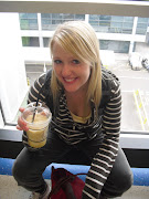 Chelsea at the London Airport drinking a smoothie. (cimg )