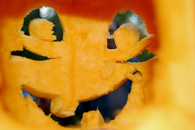 Inside of a jack-o-lantern, looking out.