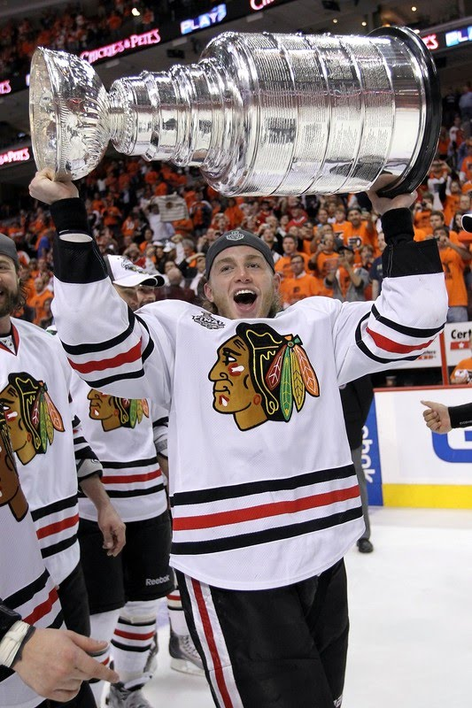 Patrick Kane #88 of the Chicago Blackhawks hoists the Stanley Cup after
