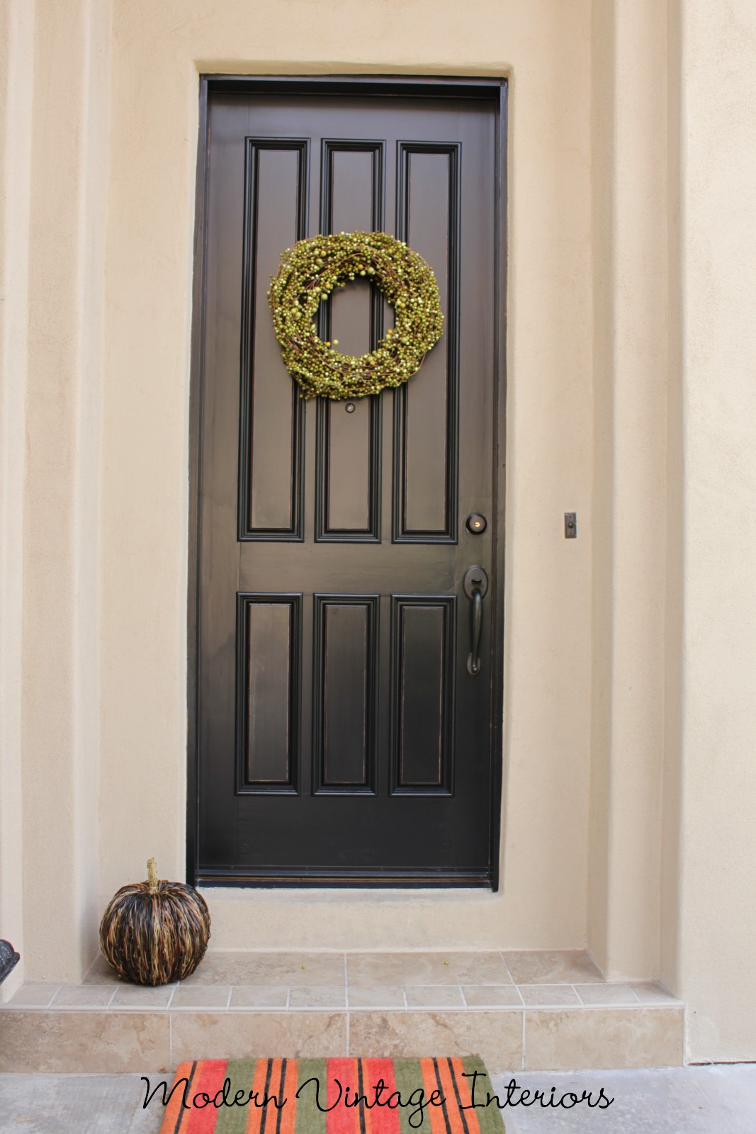 Remodelaholic painting a wooden exterior door black for Wood front entry doors