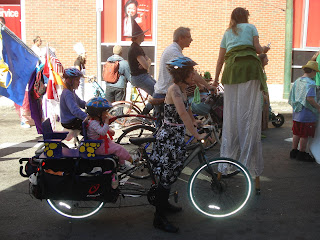 Biking in the parade -- note the stroller strapped on the Xtracycle.