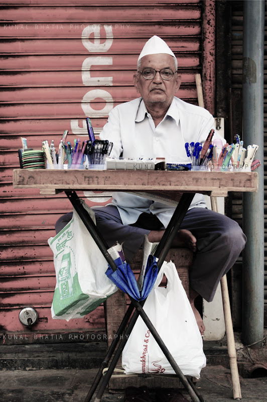 hawker vendor on street selling pens paper stationery in mumbai DN Road by kunal bhatia