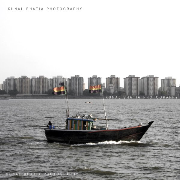 boat in arabian sea and residential apartments of colaba cuffe parade juxtaposition street mumbai india photo blog by kunal bhatia