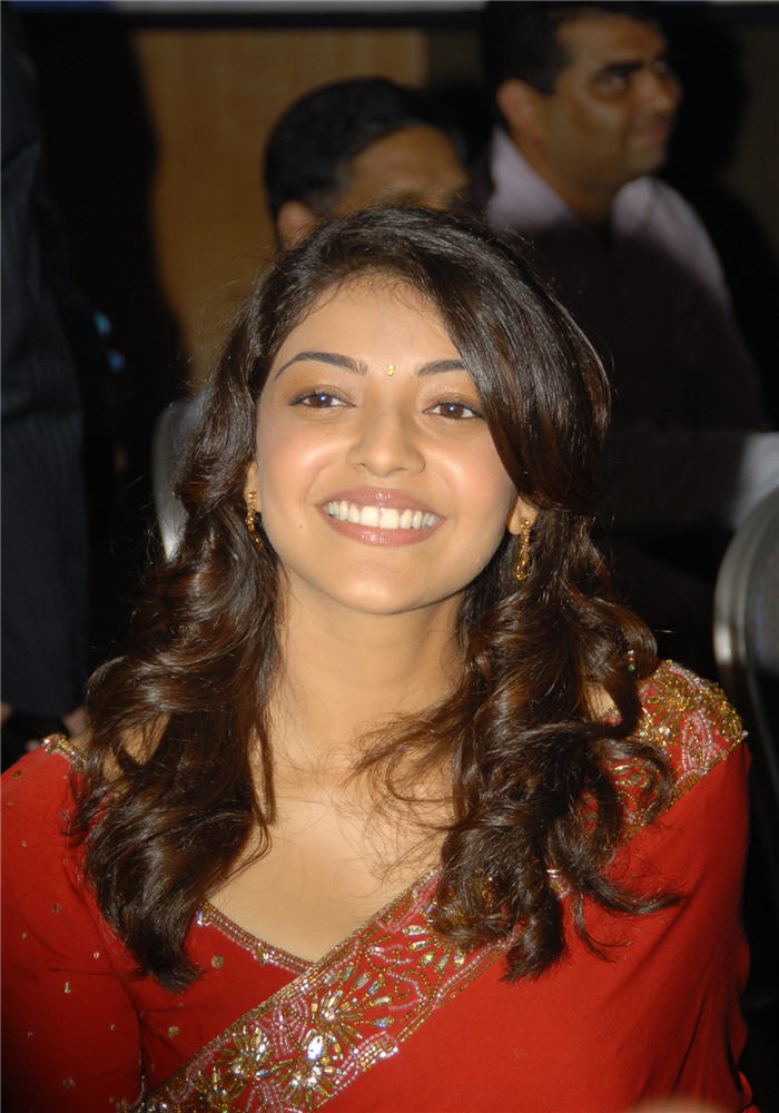 magadheera heroine kajal agarwal big c wearing red saree photo gallery