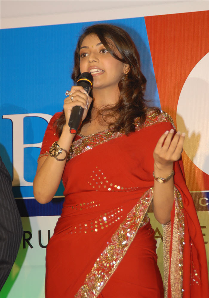 magadheera heroine kajal agarwal big c wearing red saree hot images