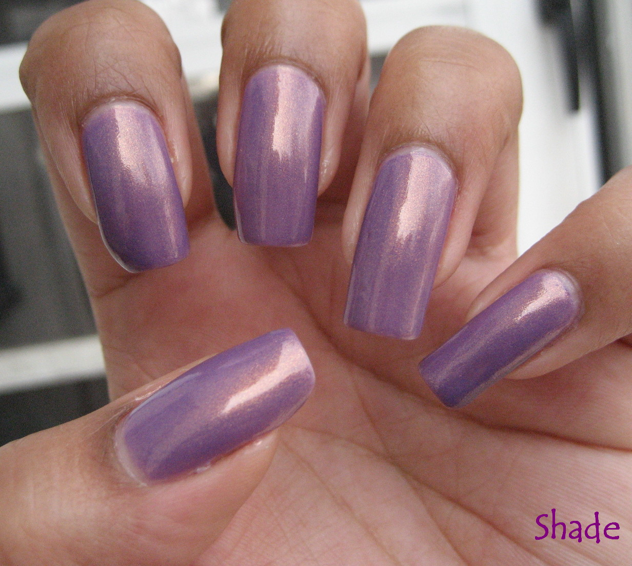 This is Zoya Zara  gorgeous lavender with a strong gold shimmery flash    Zoya Zara