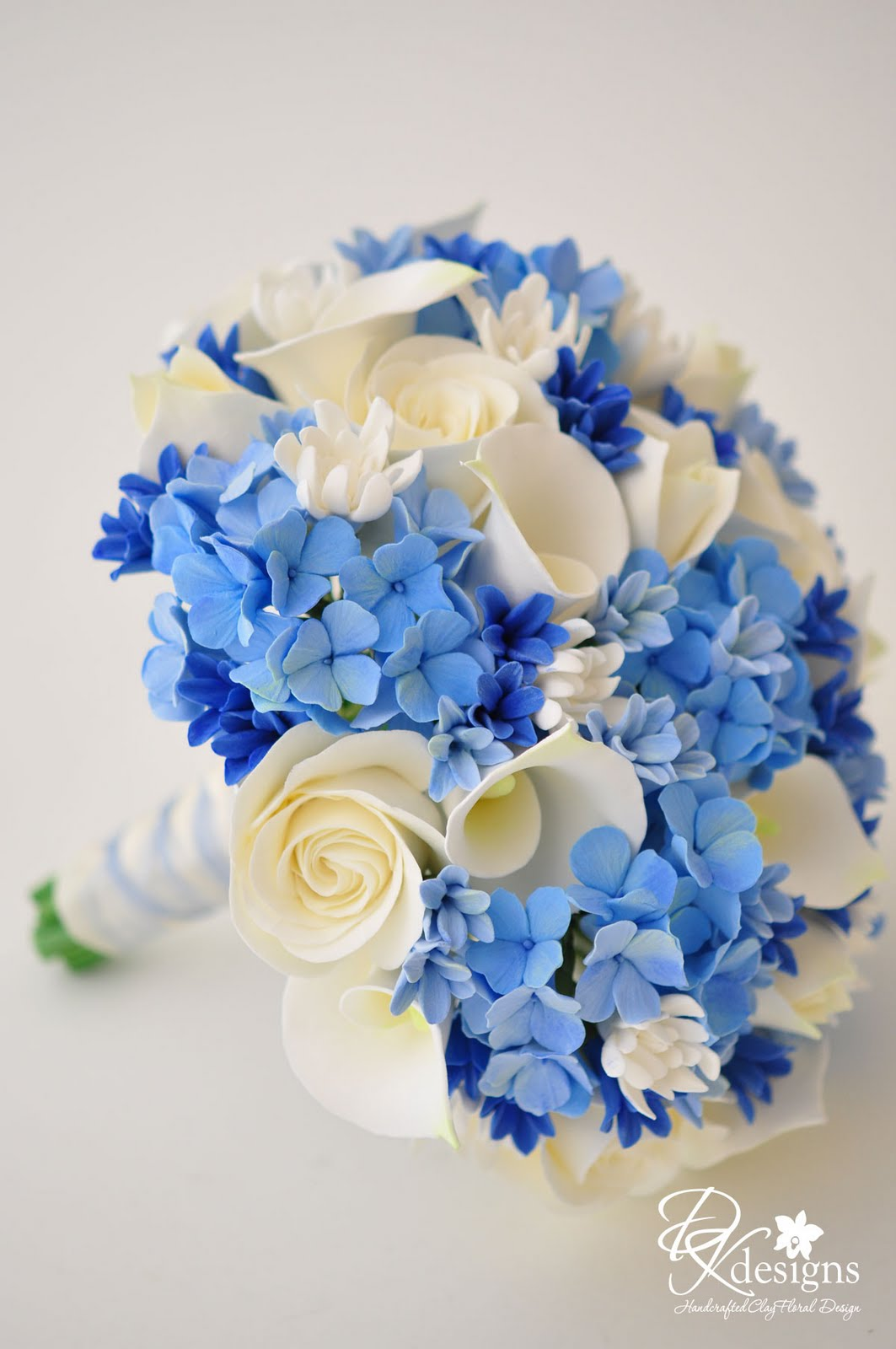 Dk designs something blue bouquet boutonniere a for Best flowers for wedding bouquet